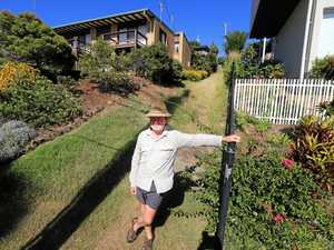 Overgrown grass leaves residents fearful of snakes