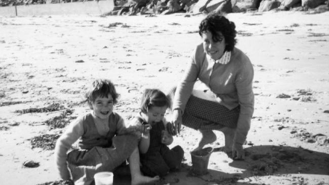 Jane and Arnna Beaumont with a friend on the beach.