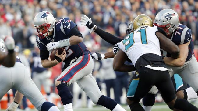New England Patriots quarterback Tom Brady scrambles during the first half  of the AFC championship game a53711a7b