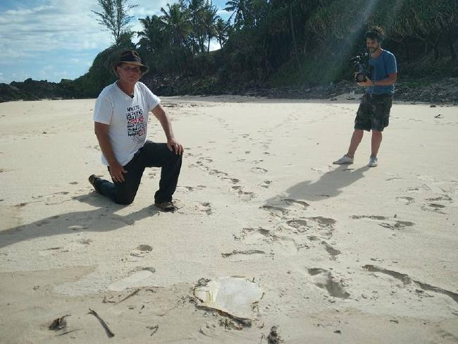 Gibson with a piece of MH370 debris found on Riake Beach, Madagascar. Picture: Facebook