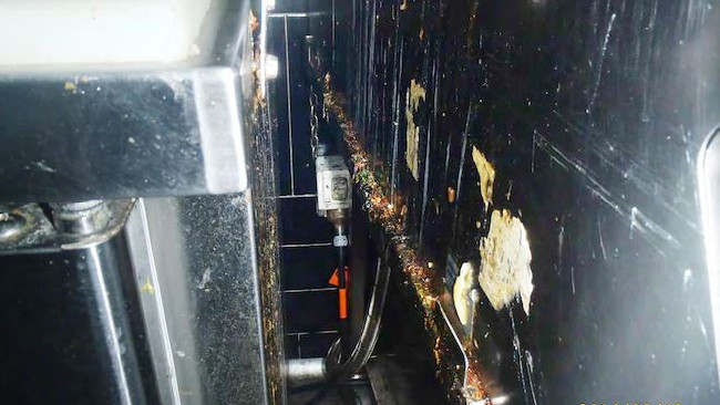 A picture taken by a council health inspector of hygiene failures and filthy equipment at Nando's Restaurant at Belmont Forum Shopping Centre.