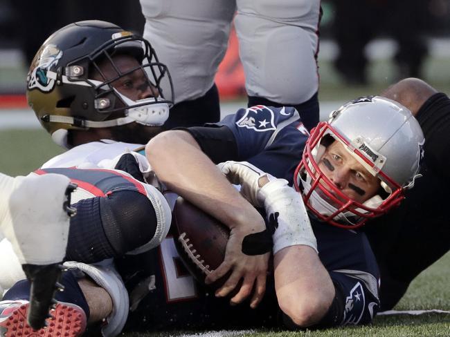 Dante Fowler introduces himself to Tom Brady. (AP Photo/David J. Phillip)