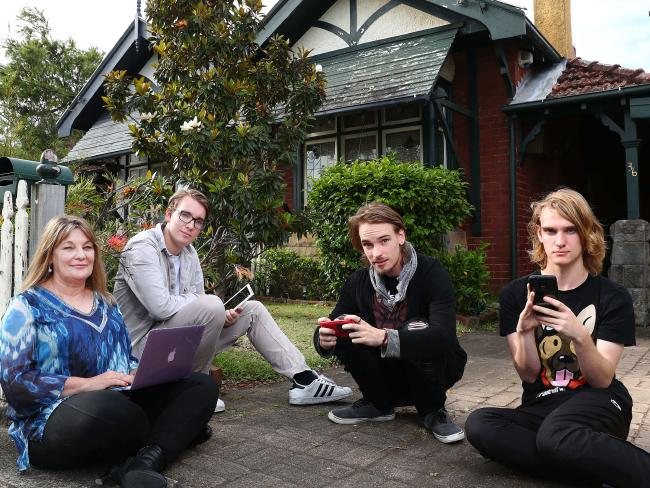 Yvonne Wallbank with her sons Alex, Max, and Nic at their house in Cremorne, Sydney. They're not happy with their NBN connection. John Feder/The Australian