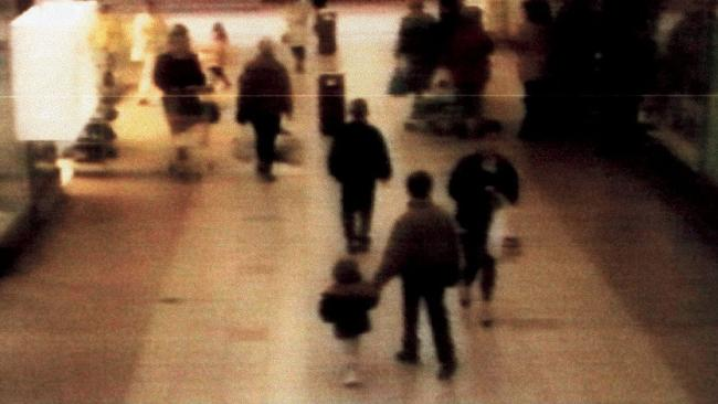 CCT footage of James Bulger being led away by his killers in The Strand shopping centre. Picture: MercuryPress/Sygma/Corbis.