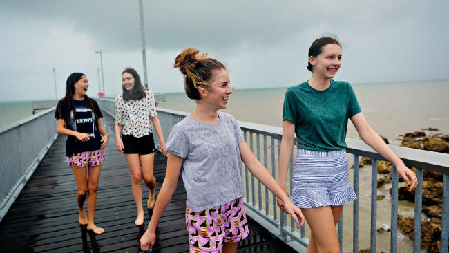 Anisha Sarib, 17, Gemma Antonino, 15, Brooklyn Engles, 15, and Zara Antonino, 17, at Nightcliff jetty enjoying the recent monsoonal weather. Picture: MICHAEL FRANCHI