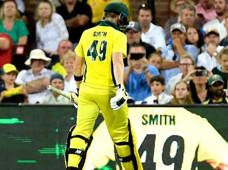 Steve Smith leaves the field after a controversial decision at the SCG.