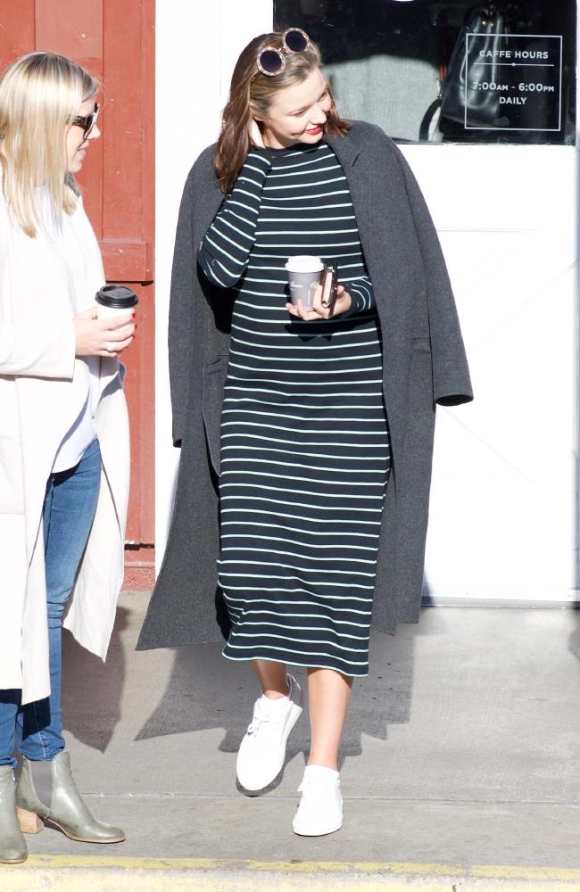 The Aussie star beams as she meets friends for a casual lunch in Los Angeles.