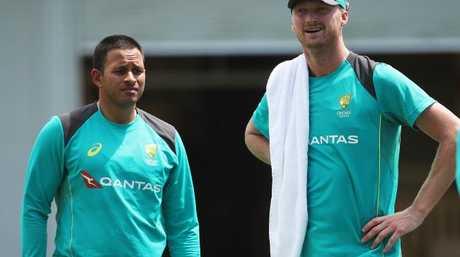 Jackson Bird (R) chats with Test No. 3 Usman Khawaja.