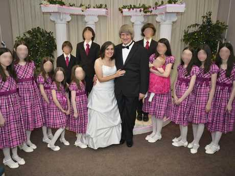 David Allen Turpin, 57, and Louise Anna Turpin, 49, with their children as the renew their vows. picture: Supplied