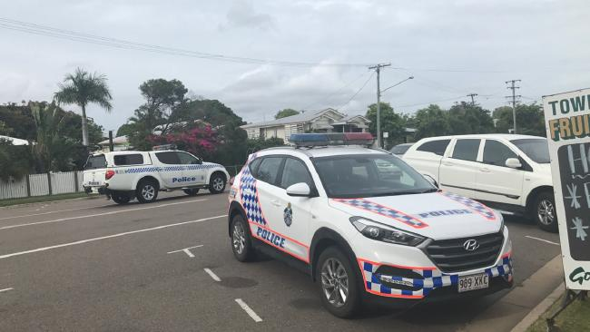 Multiple streets have been cordoned off in Currajong where police are believed to be hunting a wanted man.