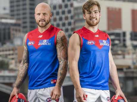 Nathan Jones and Jack Viney reveal Melbourne's new clash jumper for 2018. Picture: Jason Edwards