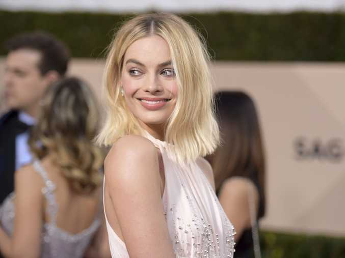 Margot Robbie arrives at the SAG Awards.