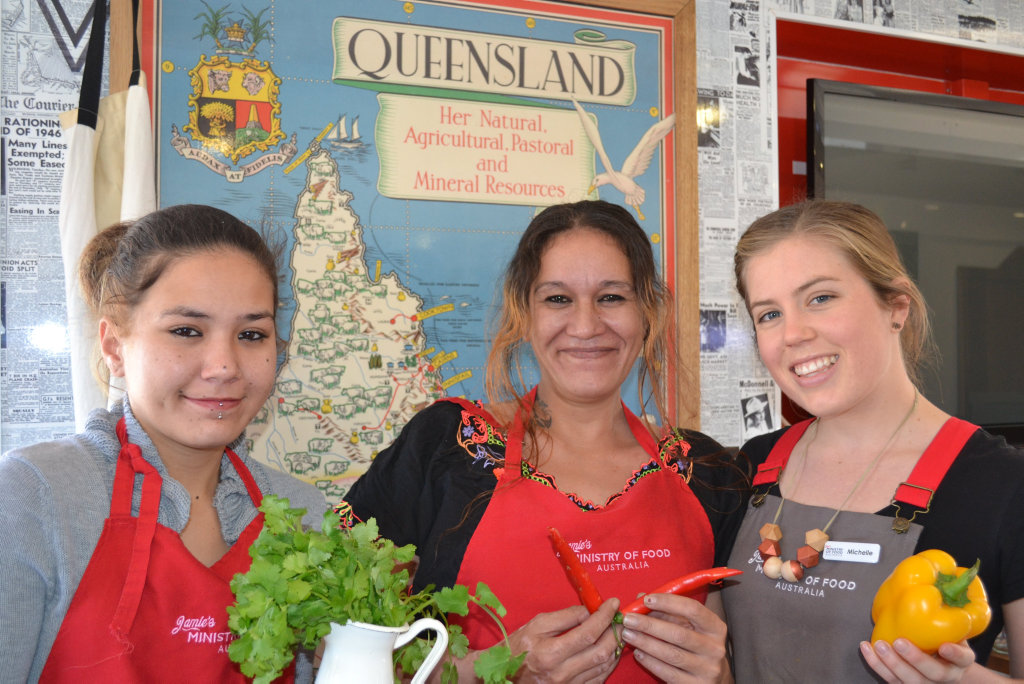Brushing up on their kitchen skills at a Jamie's Ministry of Food Van session are (from left) Talitta Lynch, Patricia Tau and Michelle Nielsen.