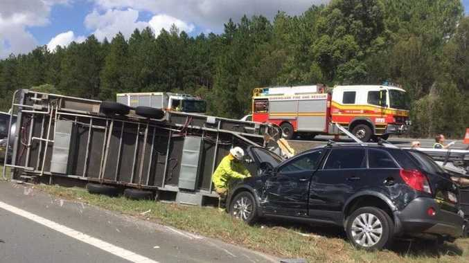 HIGHWAY HELL: A crash on the Bruce Highway has caused major delays up to 21 minutes after a semi trailer and four-wheel drive crashed.