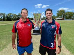 READY TO RUMBLE: Murray Harch and Jason Wells with the trophy up for grabs at the Big Bash Charity Match on Thursday night at the Rockhampton Cricket Ground.