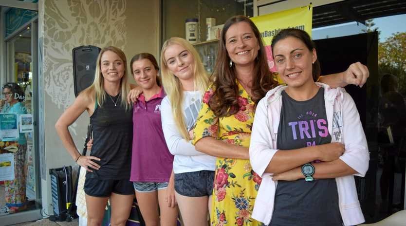 Author Taryn Bashford (in yellow) and athletes (L-R) Jane Larkin, Chloe Mclennan, Kristina Lane and Anneleise Jefferies at the book launch of the Harper Effect at Annie's Books.