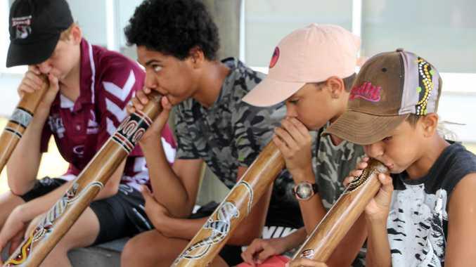 Sebastian Carr, Leighton Patterson, Dallas Hornung, Tennyson George learning the didgeridoo.