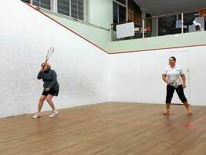 Judy Collins and Rosie Corney warm up before a ladies Thursday night match at St Mary's Squash Courts.