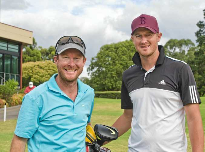 City Golf Club member Mathew Chapman (left) is all smiles with caddie Chris Veivers after qualifying on Sunday for a start in next month's Queensland PGA Championship.