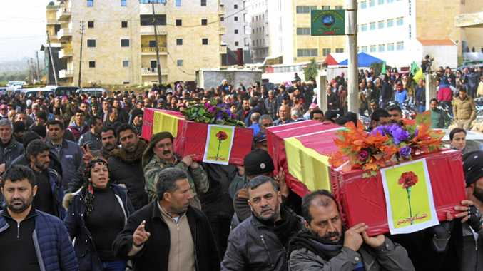 Kurdish mourners carry the coffins of people killed by Turkish shelling and air strikes in the Syrian Kurdish enclave of Afrin.
