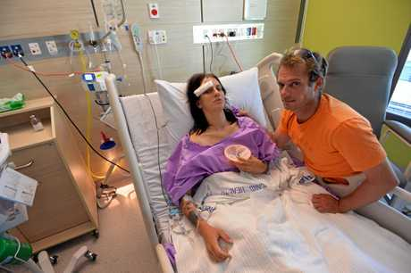 Cristy Smith and her partner Bradley Clout-Dale in hospital.