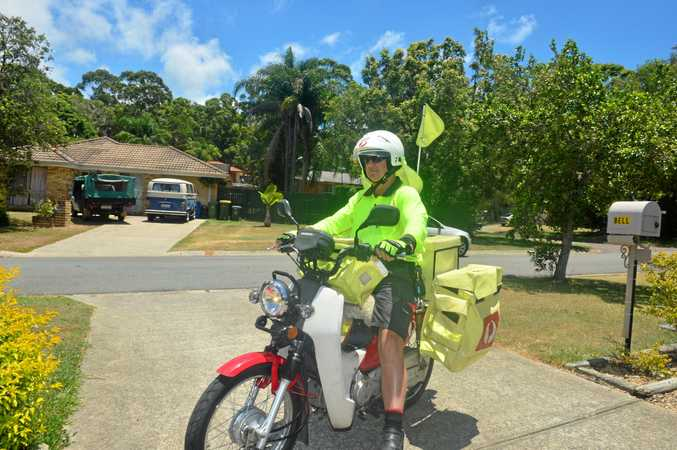 MAIL MAN: Australia Post delivery driver Dion Wilson delivers post in Caloundra.