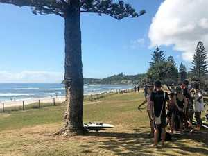 SHARK SCARE: Young girl one of six surfers in the water