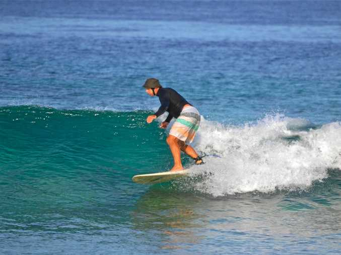 TIME TO RELAX: Dr Rob Tuffley hits the waves.