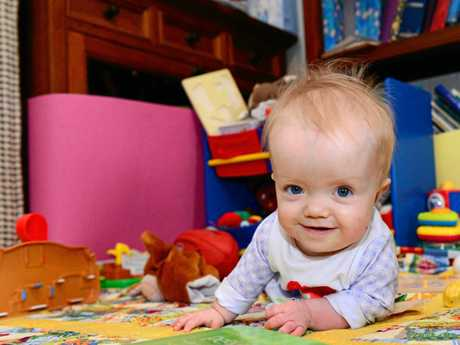 MAGGIE'S BRIGHT SMILE: Maggie Allridge, who has dwarfism, at age 14 months. Photo: File.