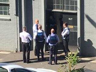 Police outside the Port Melbourne property owned by Mark 'Bomber' Thompson.