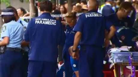 Paramedics attended the scene after a gunman silently shot the lawyer. Photo: 9NEWS