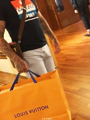Chris Rymer shops at Louis Vuitton this month after his acquittal.