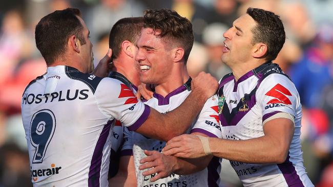 Brodie Croft of the Storm celebrates a try with team mates.