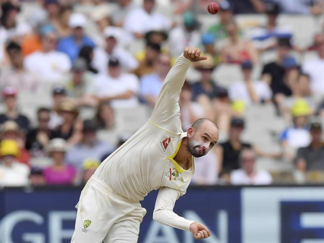 Australia's Nathan Lyon bowls to an English batsman during the Boxing Day Test this year. AP Photo/Andy Brownbill