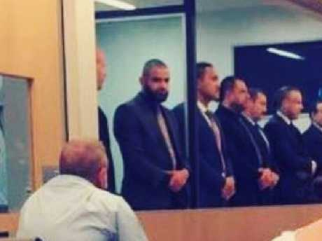 The men stand in court for the jury's not guilty verdict in a photo posted online by a supporter.