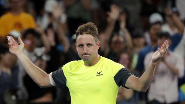 Tennys Sandgren celebrates after defeating Austria's Dominic Thiem. (AP Photo/Vincent Thian)