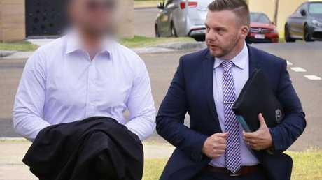 A man believed to be Salim Mehajer (left) with a police officer on Tuesday morning. Picture: NSW Police Force.