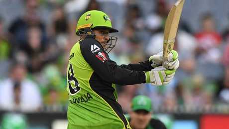 Thunder star Usman Khawaja will miss the match against the Renegades, which is critical to both teams. Picture: AAP