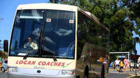A Logan Coaches bus outside Jimboomba State School yesterday. Picture: Adam Head