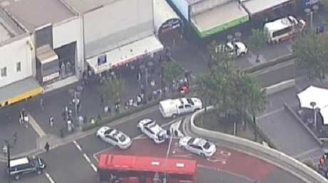 Hundreds of people fled the area after shots and screams rang out at Happy Cup Cafe. Photo: 7 NEWS