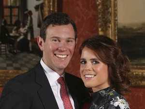Britain's Princess Eugenie of York (right) poses with her fiance Jack Brooksbank in the Picture Gallery at Buckingham Palace in London.