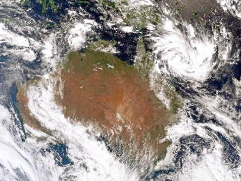 A weather radar shows a tropical low heading towards Queensland in 2017.
