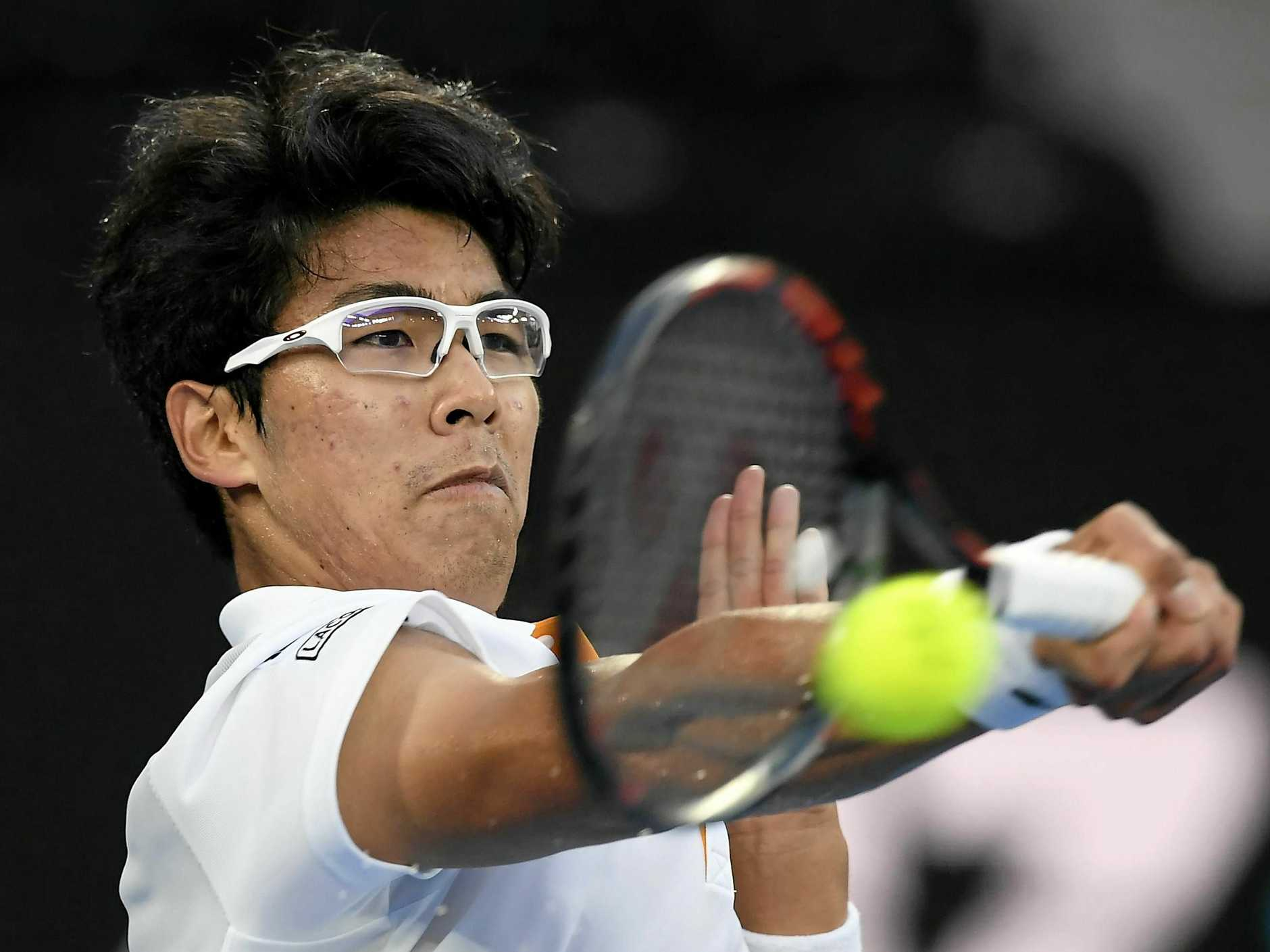 Chung Hyeon drills a forehand return against Serbia's Novak Djokovic.