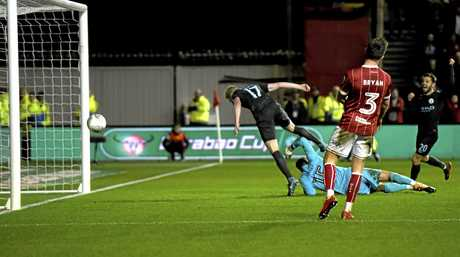 Kevin De Bruyne heads in Manchester City's winning goal against Bristol City.