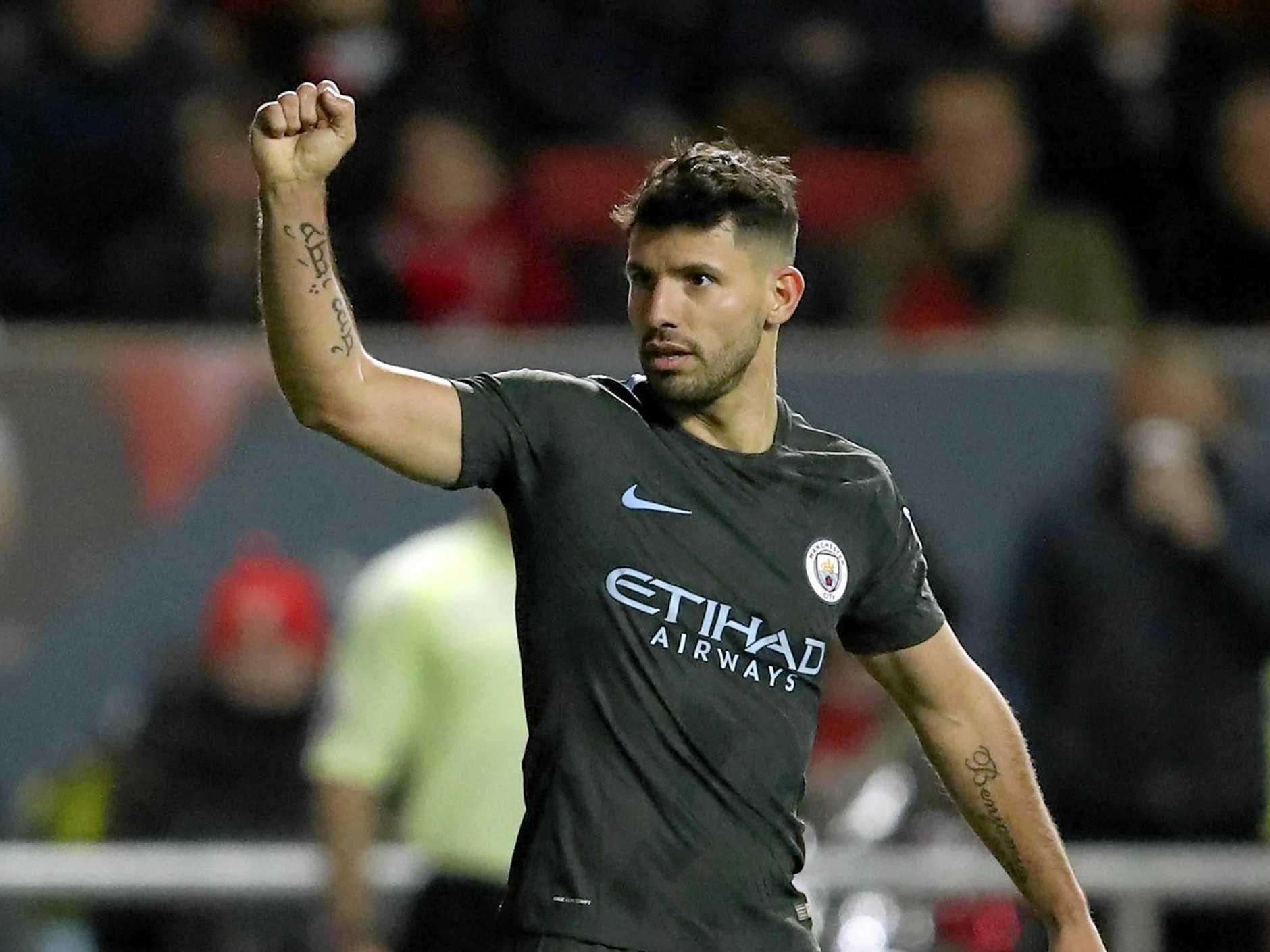 Manchester City's Argentinian striker Sergio Aguero celebrates.)