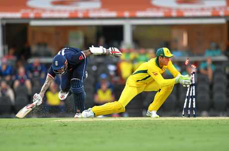 Alex Carey attempts a run out in the one-day clash against England.