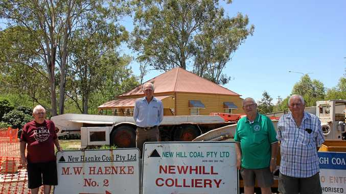 ALL MINE: Ipswich Historical Society's Norm Gehrmann, Hugh Taylor, Col King and Col Webb with the donated mine signs at the Cooneana Heritage Centre.