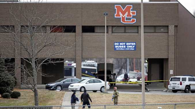 Authorities investigate the scene after a deadly shooting at Marshall County High School in Benton, Kentucky.