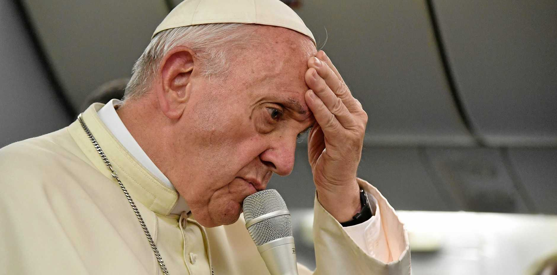 Pope Francis speaks to journalists aboard his flight to Italy at the end of his journey to South America.