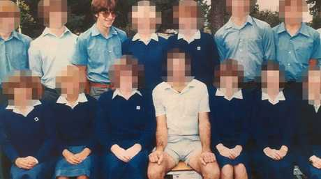 Philip, third from the back in a high school photo, around the time the abuse began.